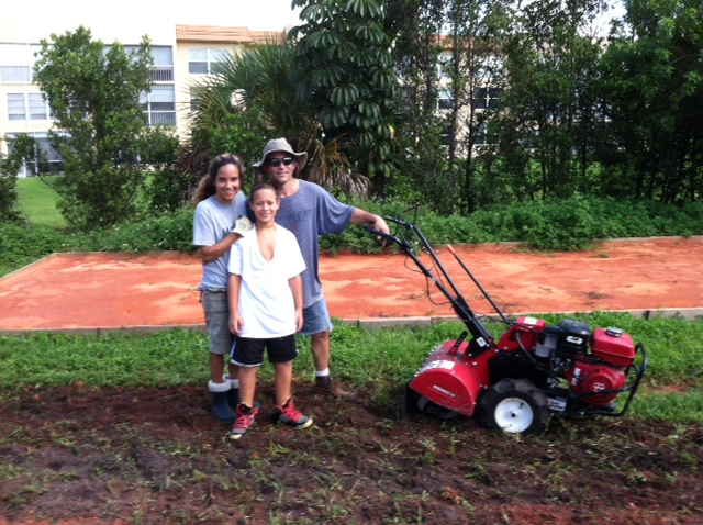 family garden shot, breaking ground